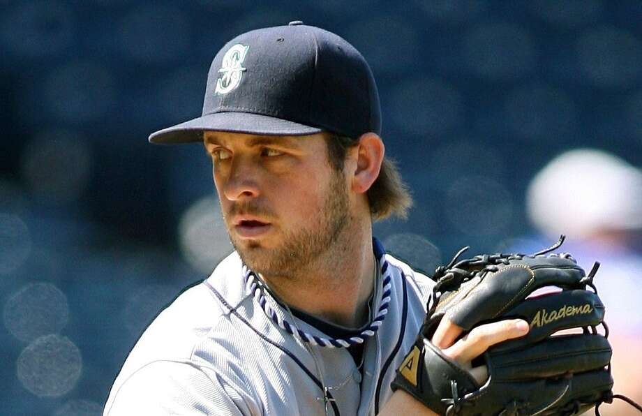 "5. Lucas LuetgeAge: 26 | Position: relief pitcherJordan: ""This guy just looks cool. Texan accent is always a turn-on. Looks like a good ol' boy."" Photo: Tim Umphrey, Getty Images / 2012 Tim Umphrey"