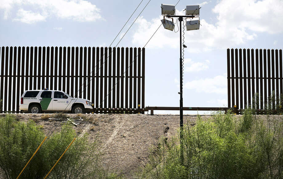A U.S. Customs and Border Protection vehicle parks near a border wall in South Texas. Empires have built walls against others, but rarely do they stand the tests of time or reason. Photo: Bob Owen, San Antonio Express-News
