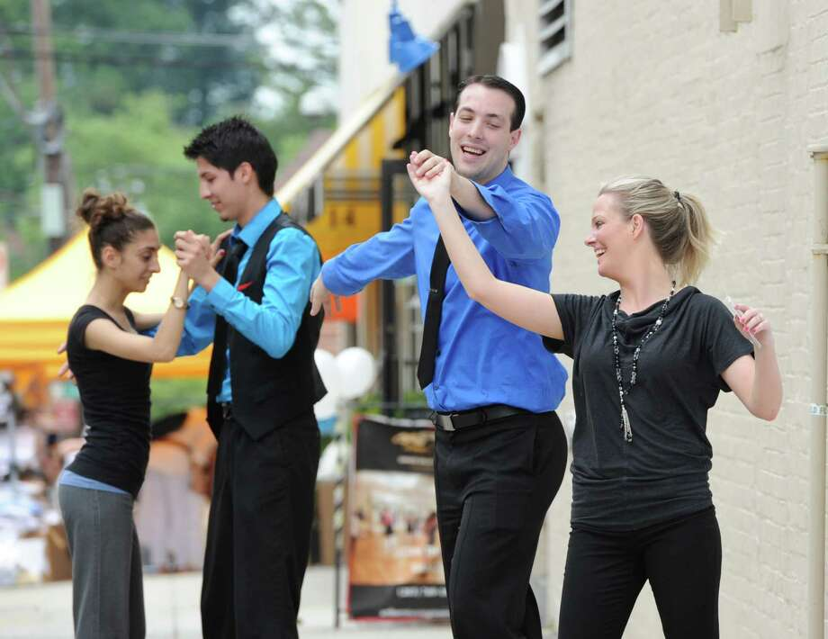 Arthur Murray dancers perform during the annual Greenwich Sidewalk Sales in the central business district of Greenwich, Thursday, July 11, 2013. Photo: Bob Luckey / Greenwich Time