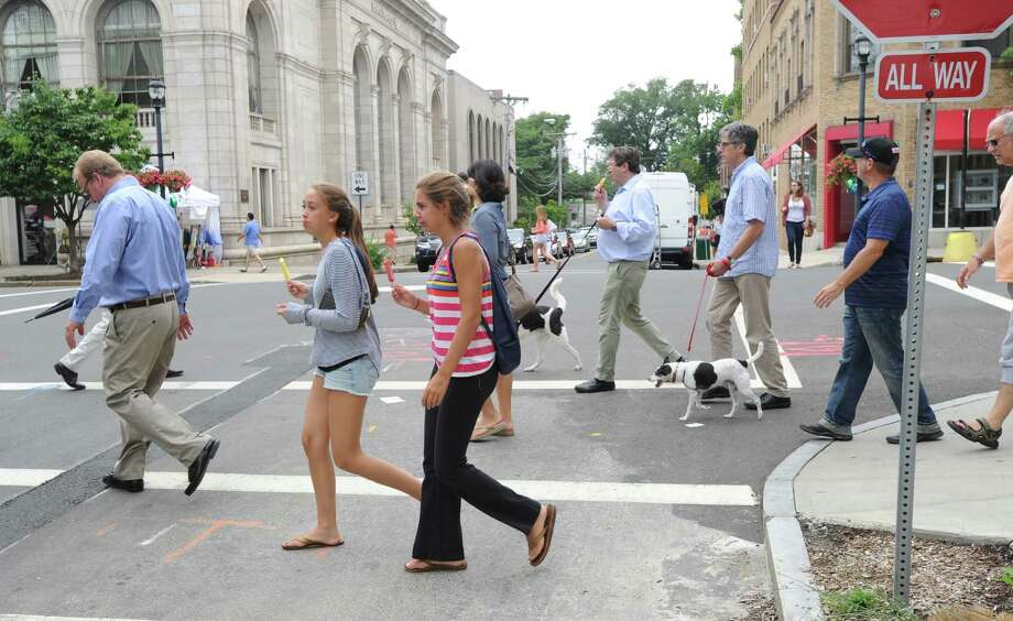 The annual Greenwich Sidewalk Sales in the central business district of Greenwich, Thursday, July 11, 2013.  Photo: Bob Luckey / Greenwich Time