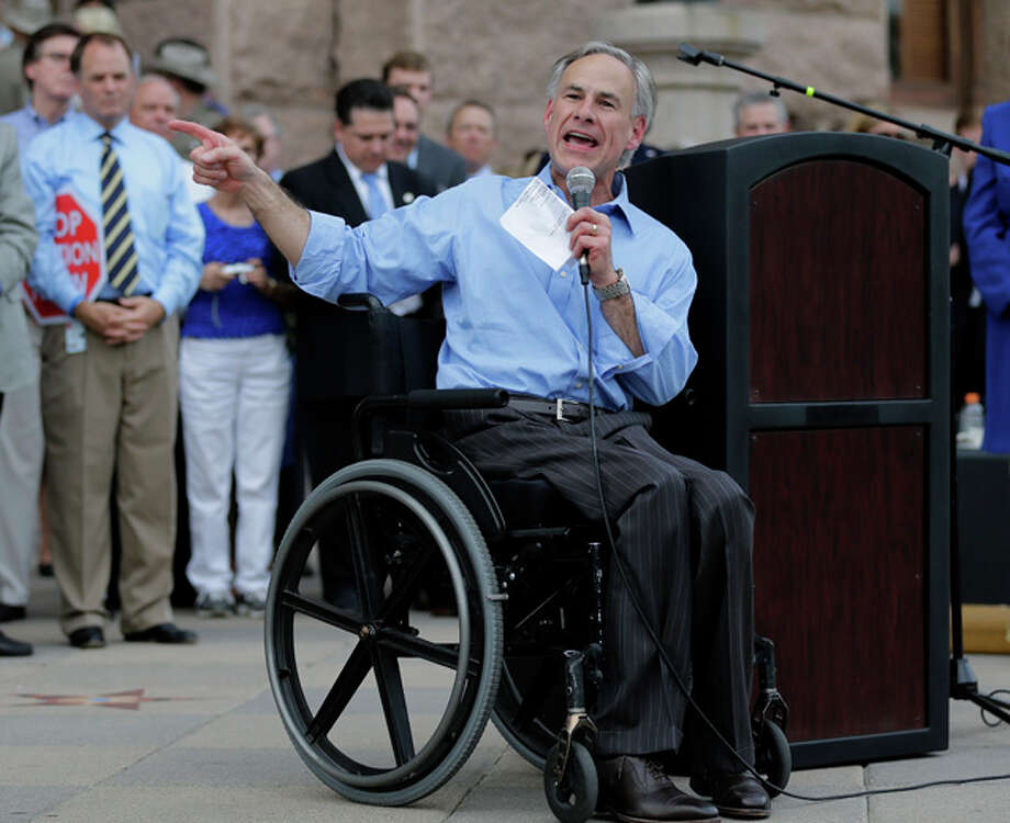 In this Monday, July 8, 2013 photo Texas Attorney General Greg Abbott speaks to a anti-abortion rally, in Austin, Texas. Photo: Eric Gay, AP / AP