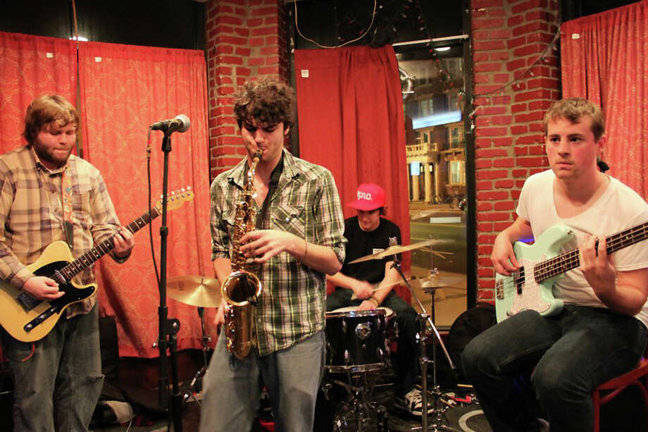 The Screw-Ups, a native Newtown band, will perform at Heirloom Arts Theatre in Danbury, on Wednesday, July 24. Left to right are Julian Wahlberg on guitar and vocals, saxophone player Nico Bonvini, Dave Manville on drums, and Kyle Kearney on bass. Photo: Contributed Photo
