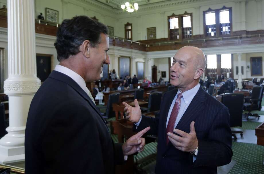 Former Pennsylvania Sen. Rick Santorum, left, talks with Sen. John Whitmire, D-Houston, right, in the Senate Chambers, Thursday, July 11, 2013, in Austin, Texas.  A Senate committee on Thursday pushed through new abortion restrictions, setting up a Senate vote before the weekend to send it to Gov. Rick Perry. The bill would require doctors to have admitting privileges at nearby hospitals, only allow abortions in surgical centers, dictate when abortion pills are taken and ban abortions after 20 weeks. (AP Photo/Eric Gay)