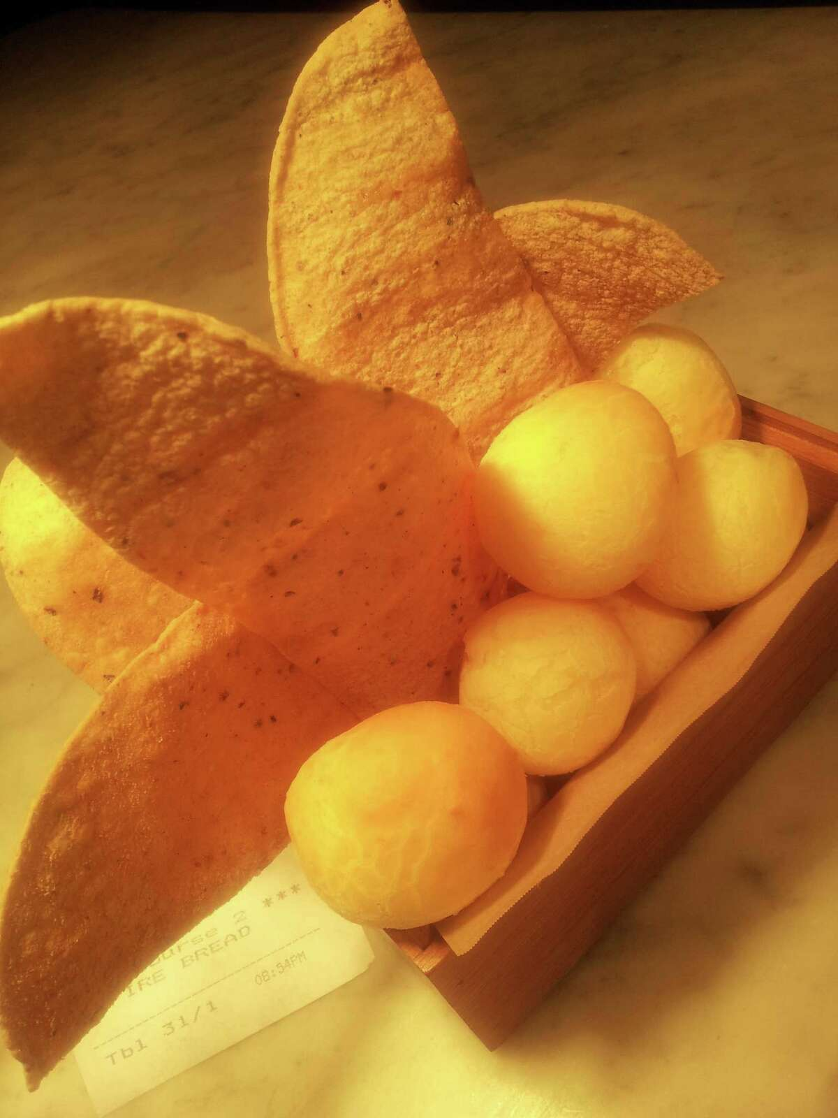 Pão de queijo (Brazilian cheese bread) is served at Nao, at the Culinary Institute of America, San Antonio.