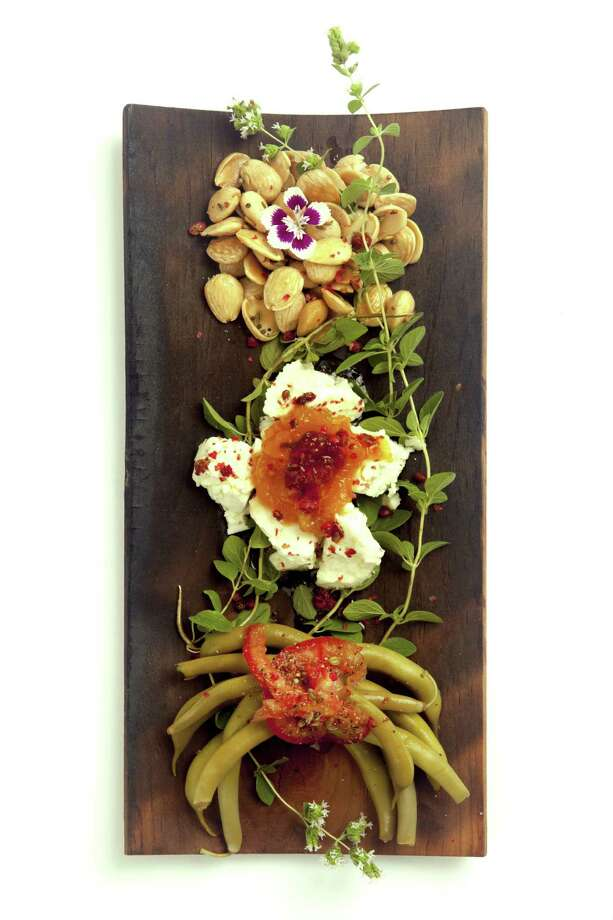 Almonds, goat cheese and pickled green beans adorn a tray at Gypsyfeed. Photo: Courtesy Alex Alvarado