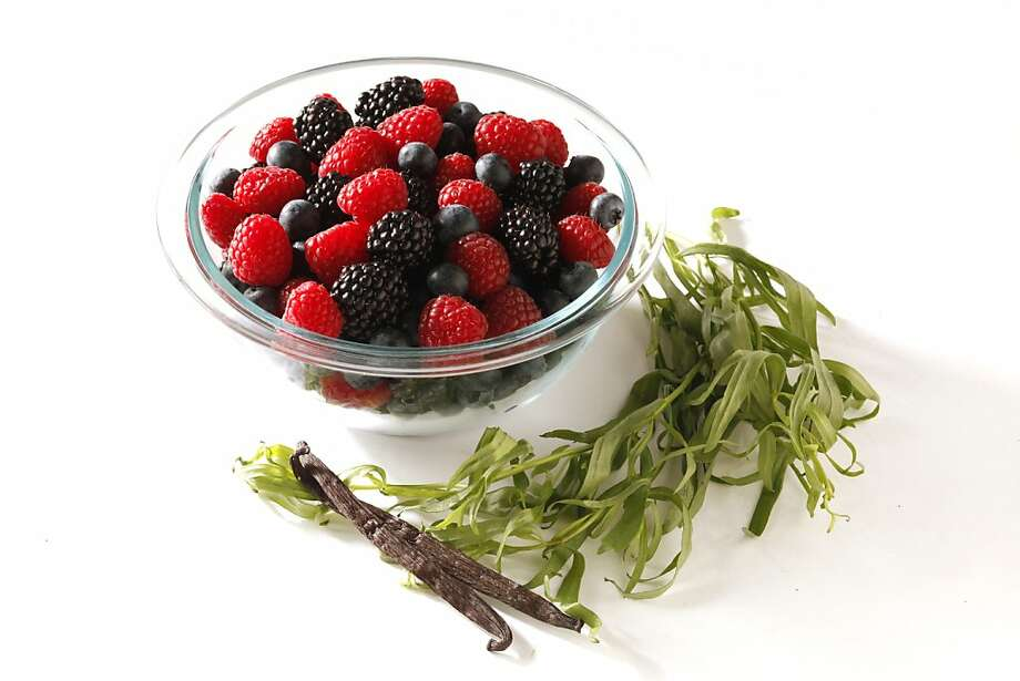 Mixed berries in vanilla tarragon syrup. Photo: Craig Lee, Special To The Chronicle