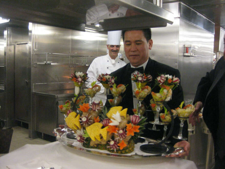 Chefs on board the Crown Princess turn fruit and vegetables into a striking work of art for the captain's table.