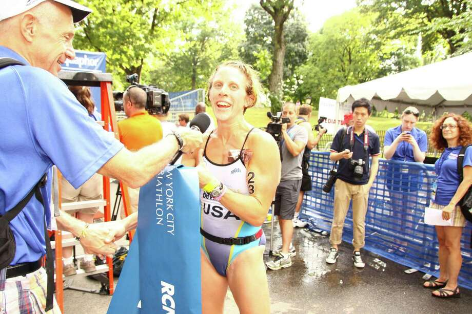 Amy Bevilacqua, a 39-year-old Wilton resident and 2012 NYC Triathlon winner, will return to the race to defend her title in the 2013 Aquaphor New York City Triathlon on July 14. Photo: Contributed Photo