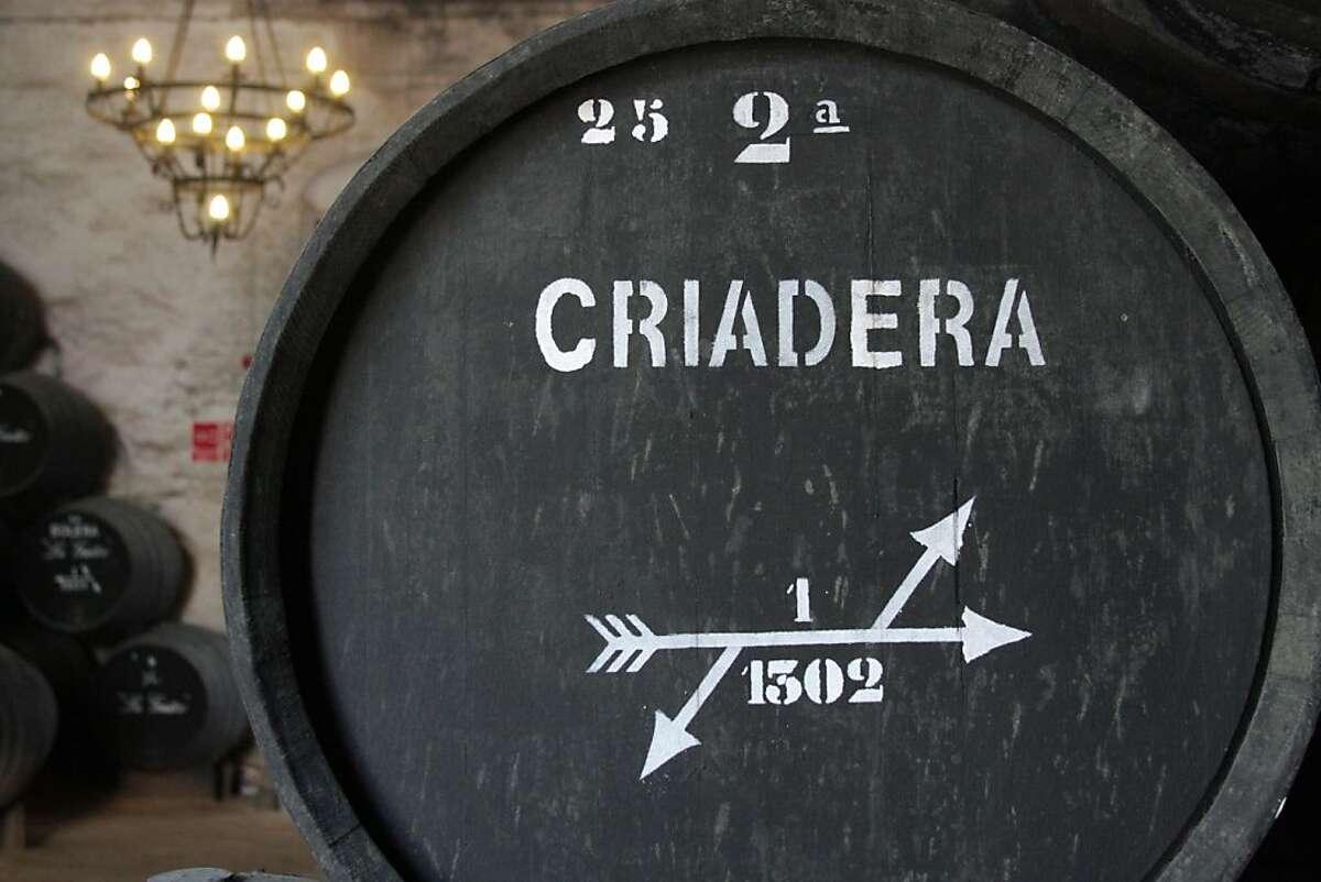 Casks of manzanilla Sherry aging at the 15th-century Misericordia bodega, part of the La Guita firm in Sanlucar de Barrameda.