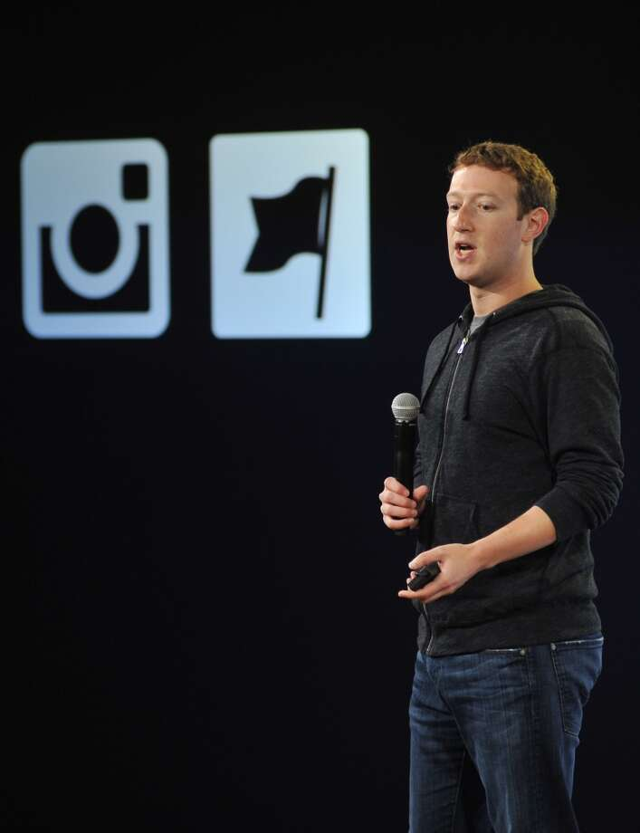Facebook CEO Mark Zuckerberg wears The Hoodie as he speaks at Facebook's corporate headquarters during a media event in Menlo Park, California, on June 20, 2013.