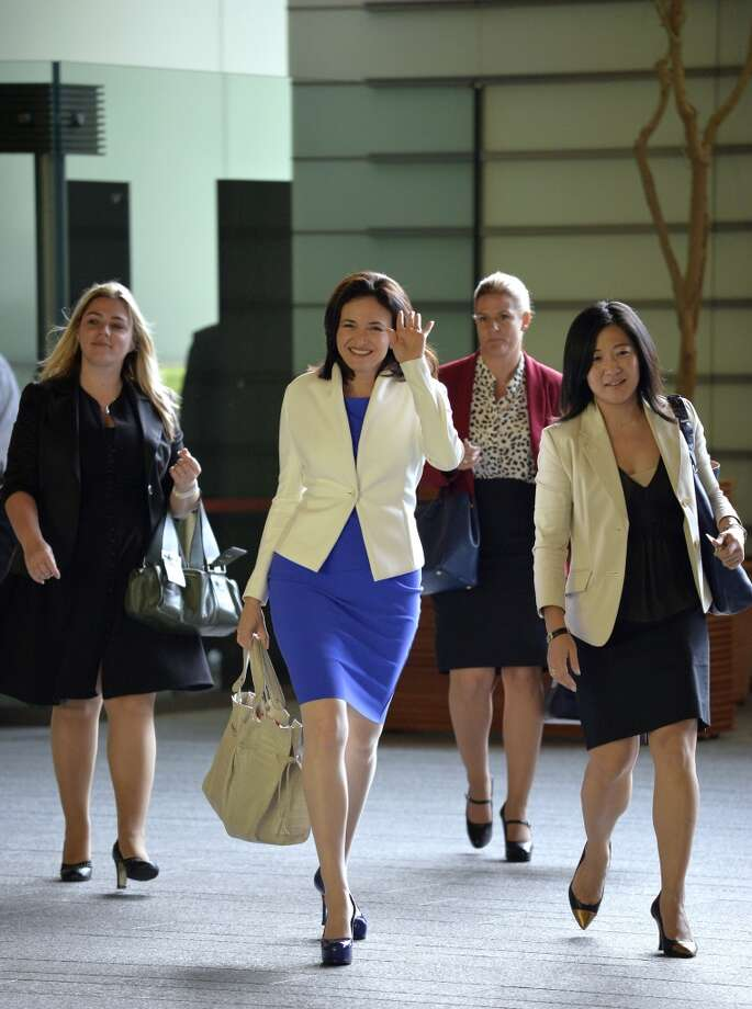 Facebook COO Sheryl Sandberg makes her pumps looks easy and waves as she arrives at Japanese Prime Minister's official residence before her meeting with Prime Minister Shinzo Abe (unseen) in Tokyo on July 2, 2013.