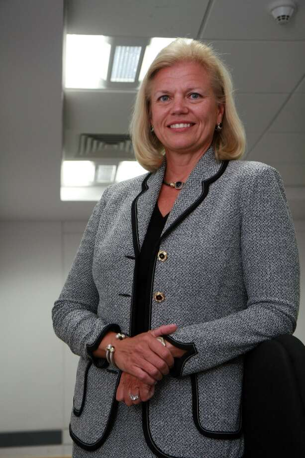 Virginia Rometty, Senior Vice President, IBM. Her feminine suits vary, but her headband is a staple.