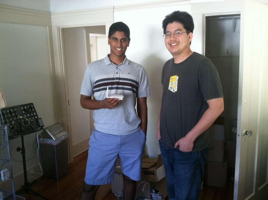 Aditya Srinivasan and John Fu testing fancy high tech gadgets that quantify shoppers and their time spent in stores.