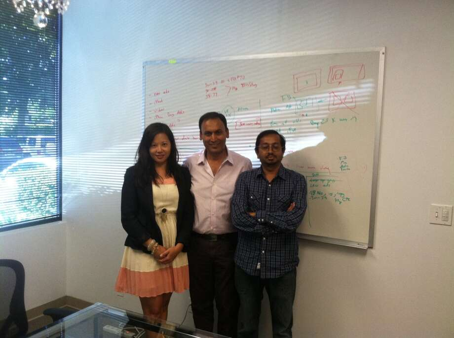 Poshmark leadership covers company secrets on the white board. Tracy Sun, Co-Founder & VP of Merchandising Manish Chandra, Founder & CEO Gautam Golwala, Co Founder & CTO.