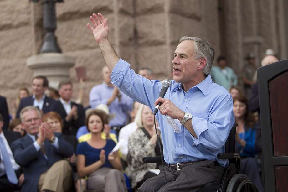In this Monday, July 8, 2013, file photo Texas Attorney General Greg Abbott speaks to a anti-abortion rally, in Austin, Texas. Abbott appears to be in no hurry to declare his candidacy for governor, even after amassing a huge campaign war chest and a sense of inevitability among conservatives who are confident he'd cruise to election. (AP Photo/Austin American-Statesman, Alberto Martínez)