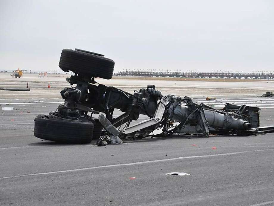 Landing gear from Asiana Airlines Flight 214 on the runway in a photo released by the National Transportation Safety Board on July 11, 2013. All debris has been removed from the runway and the runway released to airport. Photo: -, NTSB