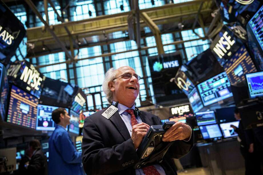 NEW YORK, NY - JULY 11:  Traders work on the floor of the New York Stock Exchange at the end of the trading day on July 11, 2013 in New York City. The Dow Jones Industrial Average closed at record high today, up 169.26 points to close at 15,460.92.  (Photo by Andrew Burton/Getty Images)  *** BESTPIX *** ORG XMIT: 168873378 Photo: Andrew Burton / 2013 Getty Images