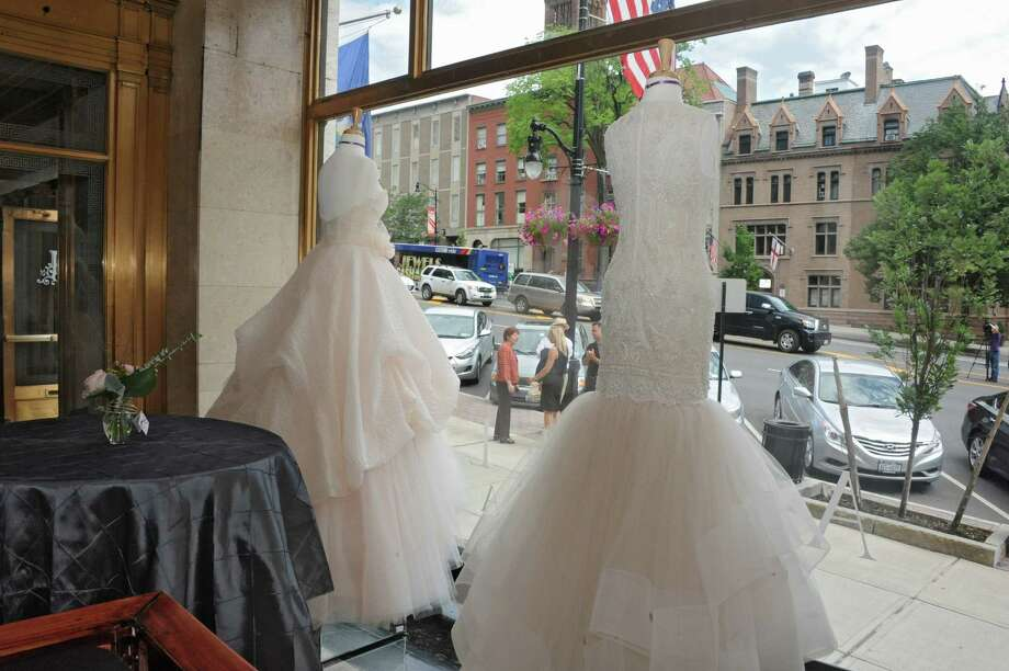 A couple of wedding dresses on display in the window of Angela's Bridal at 126 State St. Thursday, July 11, 2013 in downtown Albany, N.Y. There was ribbon cutting ceremony and tour of the new downtown store. (Lori Van Buren / Times Union) Photo: Lori Van Buren / 10023132A