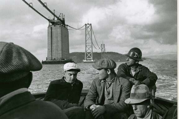 Men sail home at the end of a day of construction work on the original Bay Bridge in 1935.
