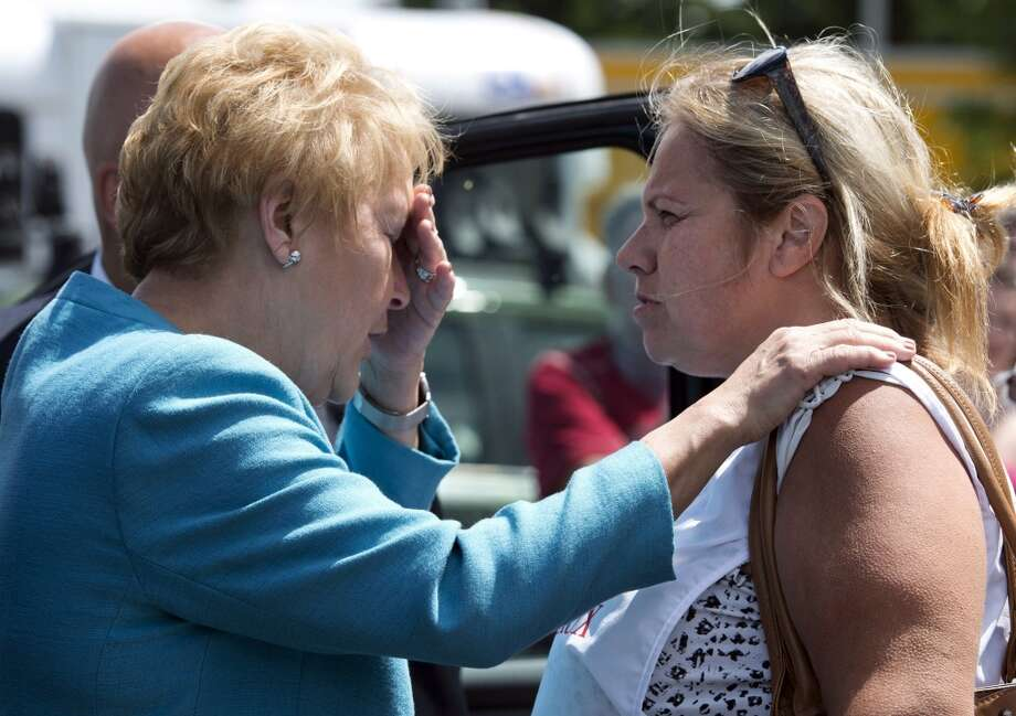 Quebec Premier Pauline Marois talks with volunteer Marie-Josee Chevrier during her visit to Lac-Megantic, Quebec, Thursday, July 11, 2013.  Marois toured the site of Canada's worst railway catastrophe in almost 150 years, after a runaway oil train killed 50 people in a fiery explosion. (AP Photo/The Canadian Press, Ryan Remiorz) Photo: Ryan Remiorz, Associated Press