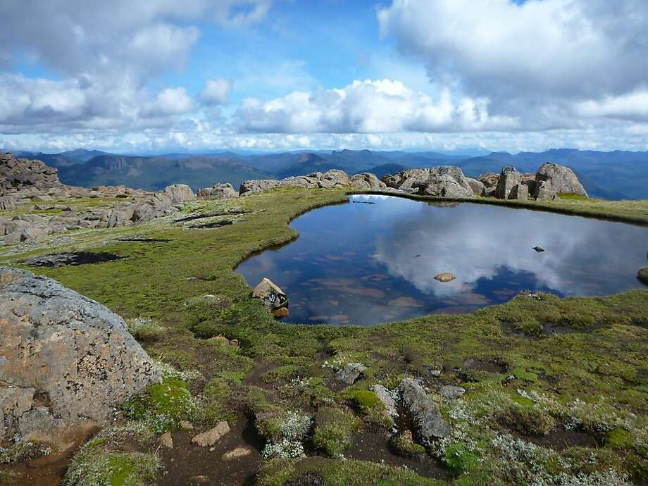 A reflective tarn below Mount Ossa's summit. Photo: Adam Smith, Special To The Chronicle
