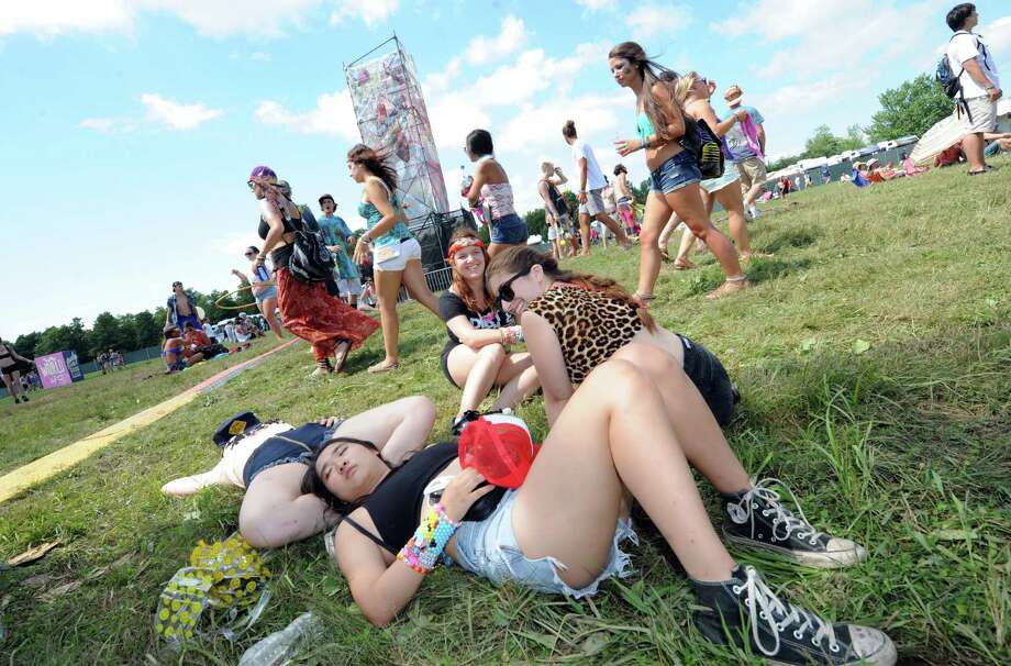 Concert goers take a break on the grass during Camp Bisco Thursday afternoon, July 11, 2013, in Mariaville, N.Y. (Michael P. Farrell/Times Union) Photo: Michael P. Farrell / 00023098A