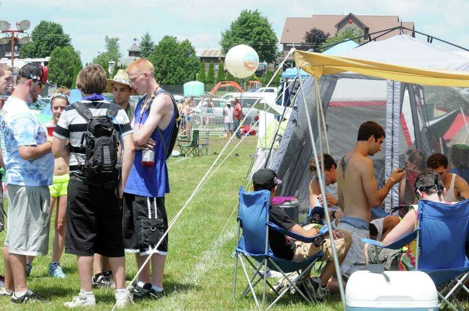 Concert goers in the camp area during Camp Bisco on Thursday afterrnoon, July 11, 2013, in Mariaville, N.Y. (Michael P. Farrell/Times Union) Photo: Michael P. Farrell / 00023098A