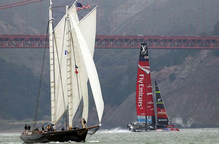 Team New Zealand passes a sailing ship during a practice run. A jury upheld a protest it filed along with Italy's Luna Rossa. Photo: Michael Macor, The Chronicle