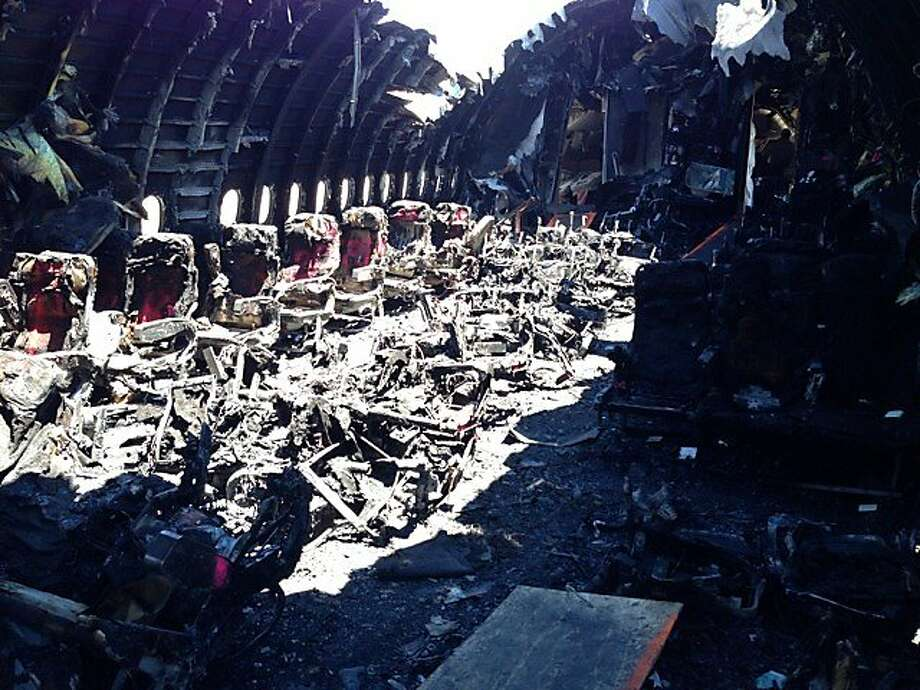 The charred cabin of Asiana Airlines Flight 214, seen in a photo released by the National Transportation Safety Board. The fire began when an engine was forced against the fuselage. Photo: -, NTSB
