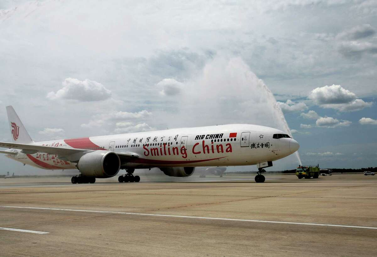The inaugural flight of Air China arrives at George Bush Intercontinental from Beijing Capital International Airport Thursday, July 11, 2013. The unprecedented partnership between Houston and China opens a new gateway and solidly connects business and leisure travelers between the fourth largest city in the U.S. and mainland China.