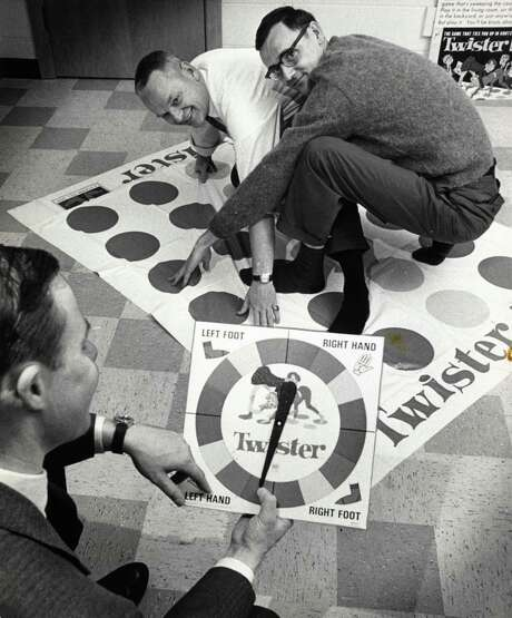 Chuck Foley (left) and Neil Rabens collaborated in 1966 on the creation of Twister, the iconic game where players tied themselves up in knots. Foley died July 1 of Alzheimer's disease. Photo: Associated Press