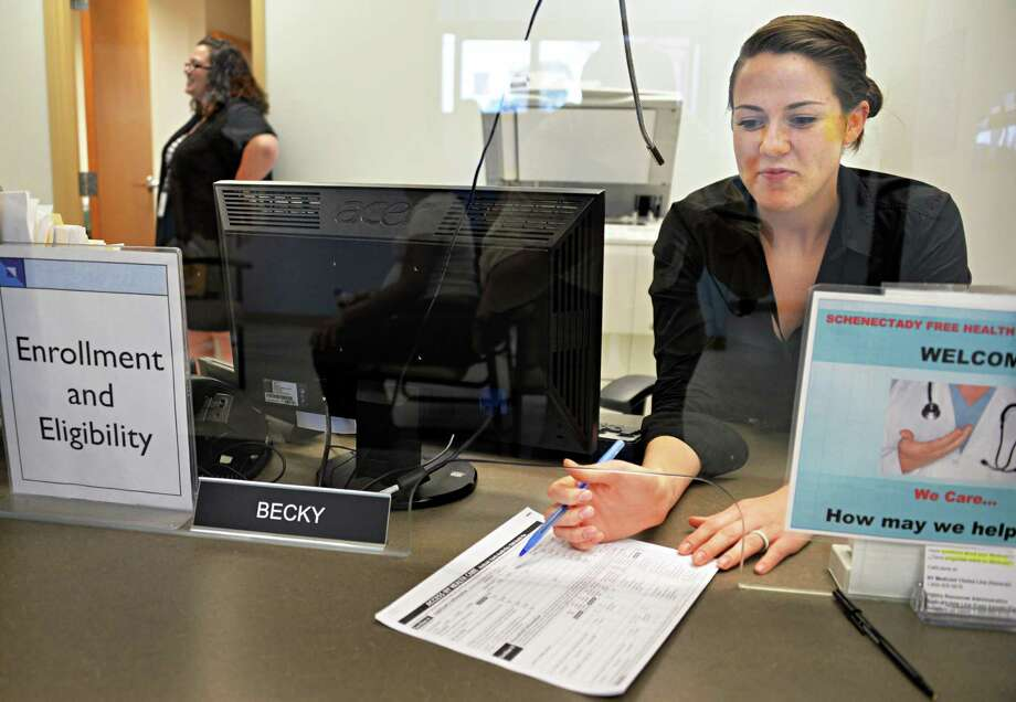 Eligibility and Enrollment coordinator Becky Staryk discusses efforts to get uninsured people to sign up for insurance Wednesday July 10, 2013, at Hometown Health in Schenectady, N.Y. Starzyk helps to enroll patients in existing public health programs. (John Carl D'Annibale / Times Union) Photo: John Carl D'Annibale / 10023118A