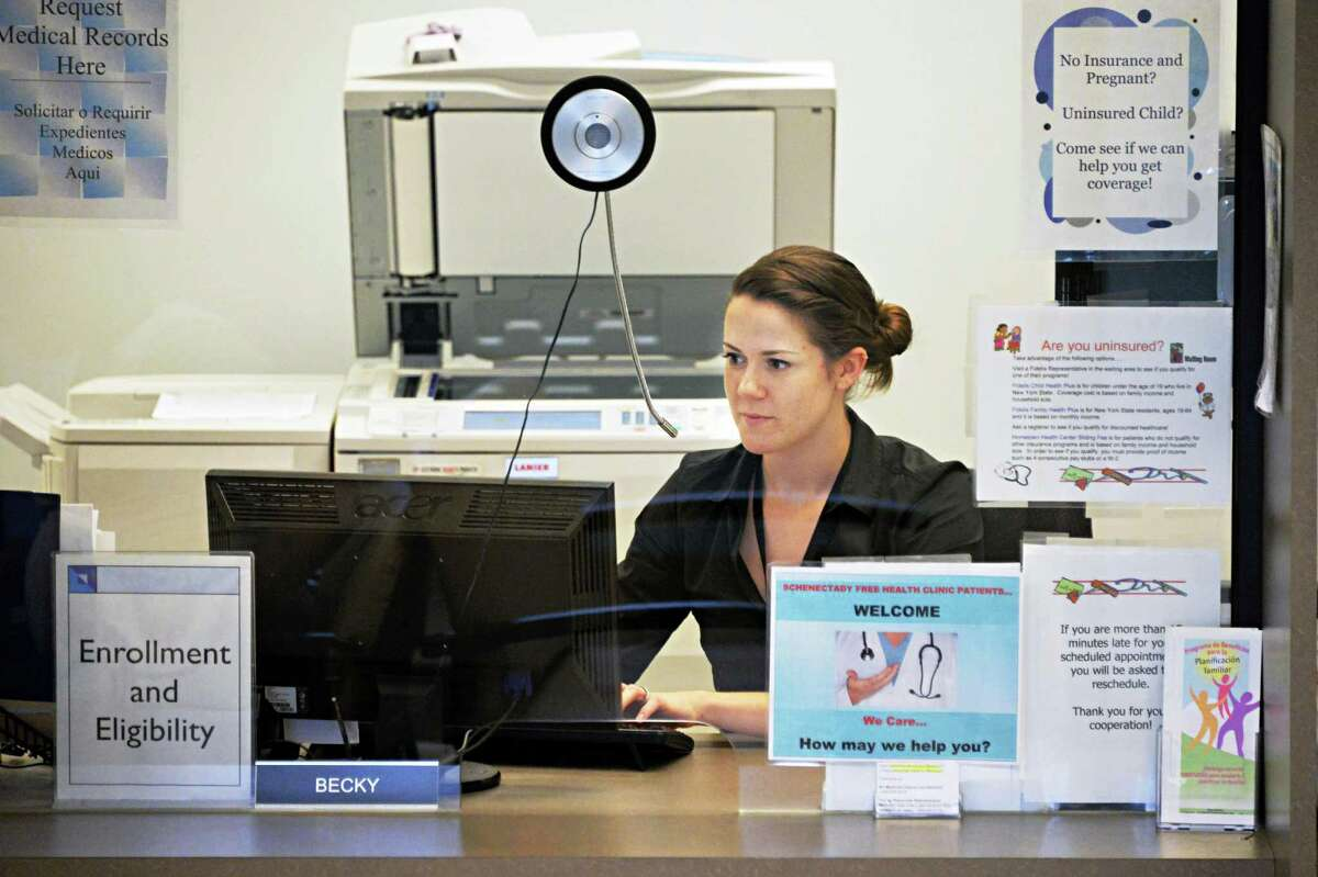 Eligibility and Enrollment coordinator Becky Staryk is pictured behind her desk Wednesday July 10, 2013, at Hometown Health in Schenectady, N.Y. Starzyk helps to enroll patients in existing public health programs. (John Carl D'Annibale / Times Union)