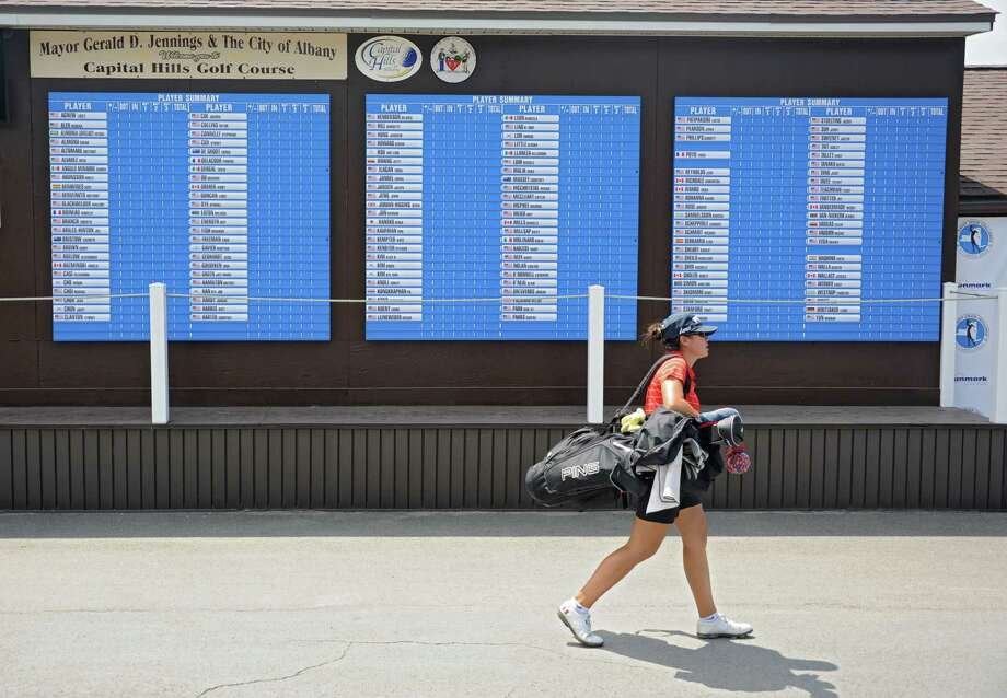 A golfer walks past the scoreboard for the Symetra Tour, Road To the LPGA tournament at Capital Hills Golf Course Thursday, July 11, 2013, in Albany, N.Y. The tournament will be held this weekend. (Lori Van Buren / Times Union) Photo: Lori Van Buren / 10023136A