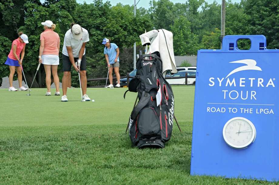Golfers practice their putting for the Symetra Tour, Road To the LPGA tournament at Capital Hills Golf Course Thursday, July 11, 2013, in Albany, N.Y. The tournament will be held this weekend. (Lori Van Buren / Times Union) Photo: Lori Van Buren / 10023136A