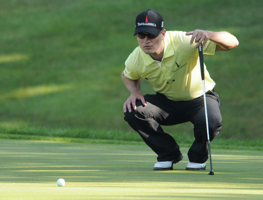 Zach Johnson lines up a putt on the 15th hole during the John Deere Classic golf tournament's pro-am in Silvis, Ill., Thursday, July 11, 2013. (AP Photo/The Dispatch, Gary Krambeck)  QUAD CITY TIMES OUT ORG XMIT: ILMOL102 Photo: Gary Krambeck / The Dispatch