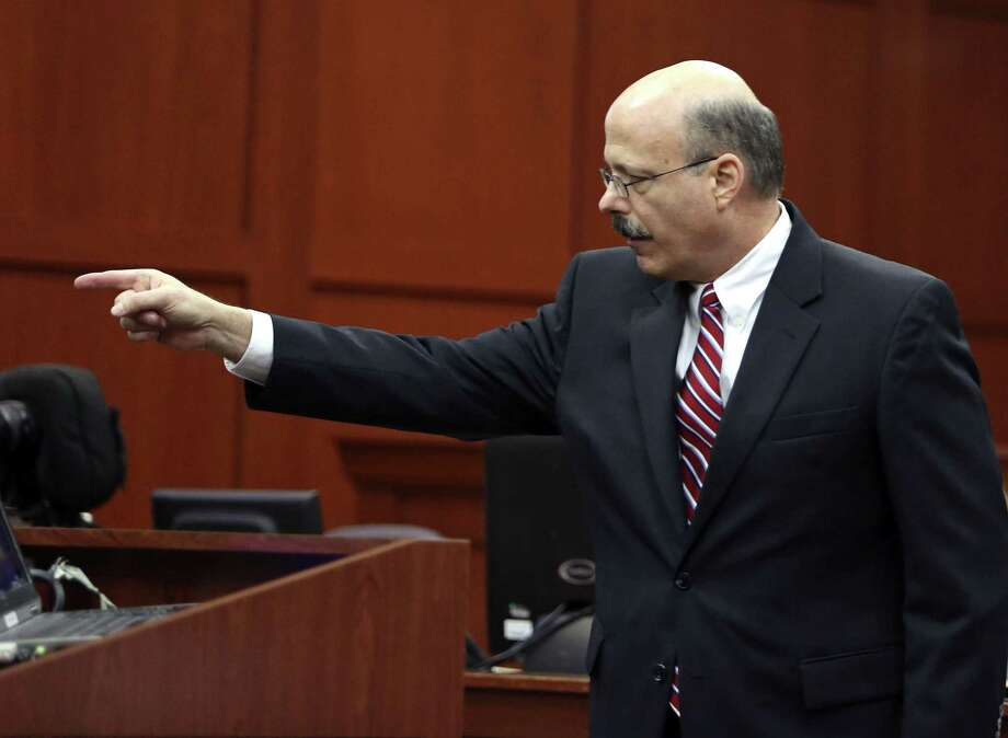 """Prosecutor Bernie de la Rionda, pointing to George Zimmerman in closing arguments, says the defendant's mind was muddied by """"incorrect assumptions."""" Photo: Gary W. Green / Orlando Sentinel"""