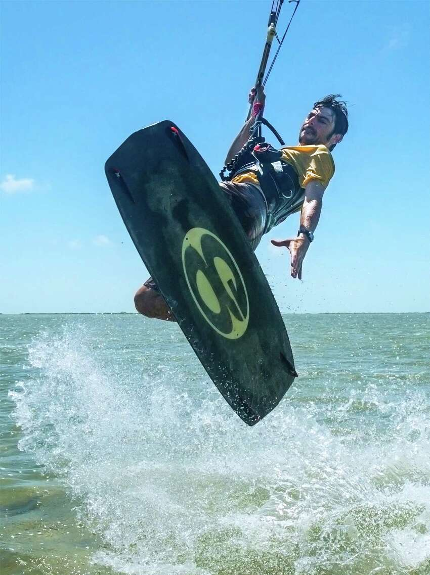 Interested in trying kitesurfing? Jamie Ellwood of Third Coast Kitesurfing in Port Aransas offered these tips and more to know before getting started: PHOTO: Ellwood takes a leap while teaching a kitesurfing lesson outside Port Aransas.