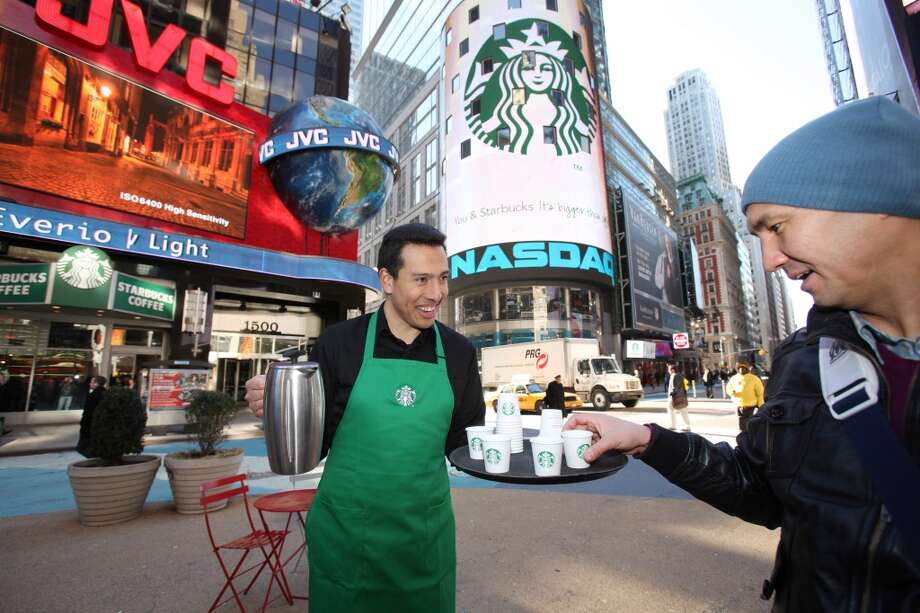 The busiest Starbucks in America? It's in Times Square, where Starbucks debuted its flashy, remodeled New York flagship in 2011. It has a snazzy billboard and big tourist crowds, bringing in $6 million in annual sales, Alstead said. Photo: Photo Courtesy  Starbucks