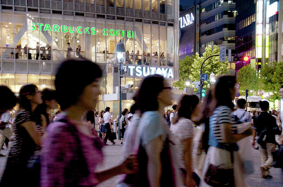 Best Starbucks to watch the scramble of humanity: Above Tokyo's famously crowded Shibuya intersection, where great swarms of pedestrians use the crosswalks at the same time. For fun, watch the video here. Photo: Yoshikazu TAKADA, Creative Commons Flickr