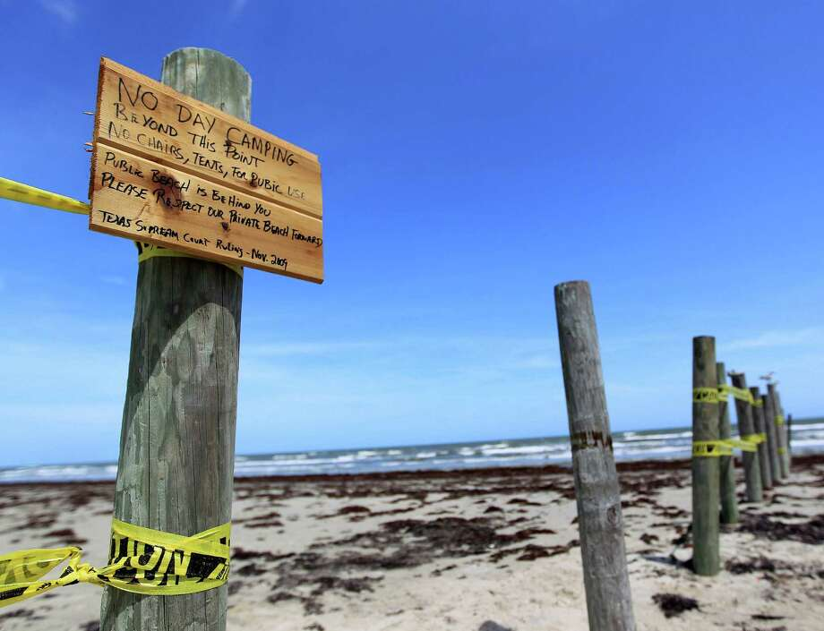 """A hand-painted sign on Hershey Beach reads """"No day camping beyond this point"""" and bans chairs or tents. """"Public beach is behind you. Please respect our private beach."""" Photo: Karen Warren, Staff / © 2013 Houston Chronicle"""