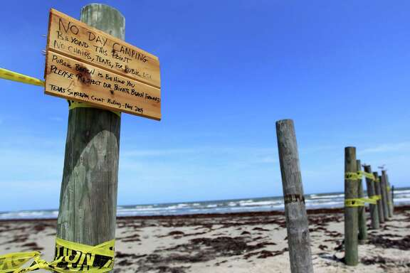 "A hand-painted sign on Hershey Beach reads ""No day camping beyond this point"" and bans chairs or tents. ""Public beach is behind you. Please respect our private beach."""