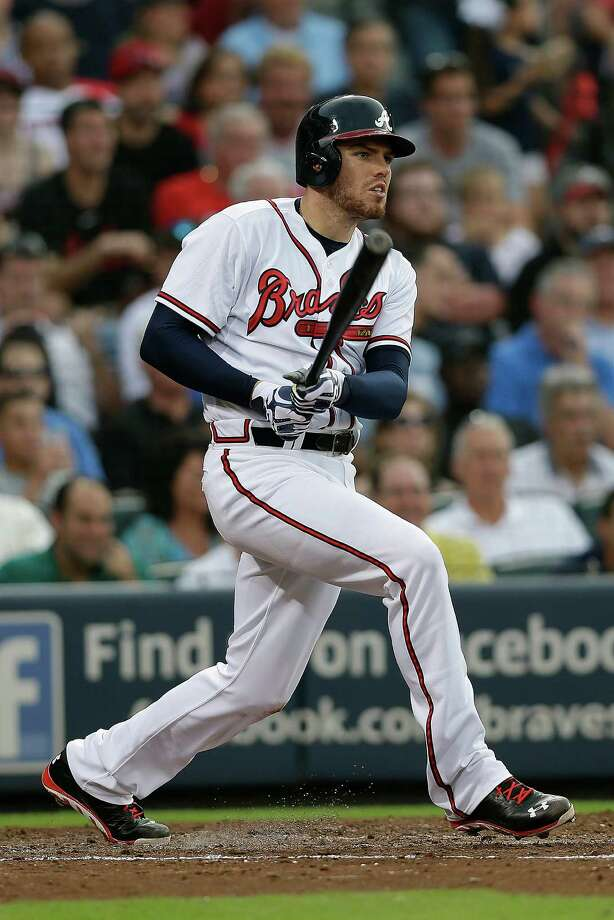 Atlanta Braves' Freddie Freeman drives in a run with a base hit in the second inning of a baseball game against the Cincinnati Reds, Thursday, July 11, 2013, in Atlanta. (AP Photo/John Bazemore)  ORG XMIT: GAJB106 Photo: John Bazemore / AP