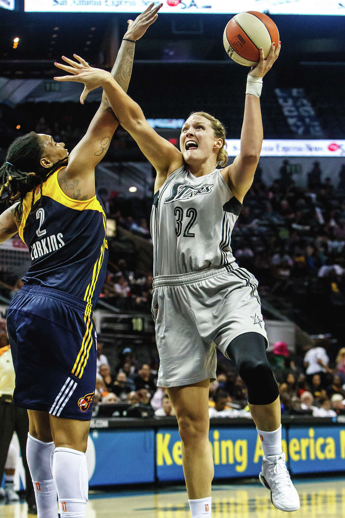 Jayne Appel (right) goes to the basket around Indiana's Erlana Larkins during the second half of the San Antonio Silver Stars 2013 season opener against the defending WNBA champions at the AT&T Center on Friday, May 24, 2013. The Fever won the game 79-64.