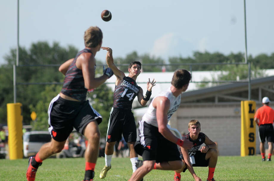 East Bernard senior quarterback Grant Aschenbeck, center, is using his time at the Division II 7-on-7 State Championship to get acclimated to being the main signal caller ahead of the regular season. Photo: Jerry Baker, Freelance