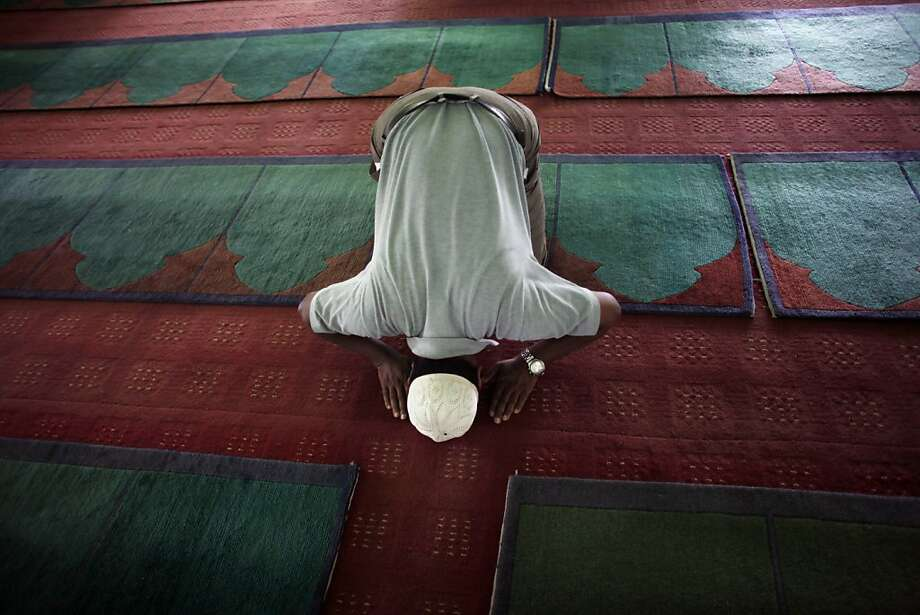 A Nepalese Muslim offers prayers at a mosque in Katmandu, Nepal, Thursday, July 11, 2013. Muslims throughout the world are celebrating the holy fasting month of Ramadan, refraining from eating, drinking, and smoking from dawn to dusk. (AP Photo/Niranjan Shrestha) Photo: Niranjan Shrestha, Associated Press