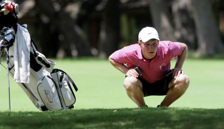 Wes Artac of Kingwood, TX, looks for an opening after hitting his drive on the 12th hold of the AJGA Genesis Shootout presented by the Valero Texas Open on Thursday, July 11, 2013, at Fair Oaks Ranch Golf and Country Club on the Live Oak Course. Photo: Bob Owen, San Antonio Express-News / © 2012 San Antonio Express-News