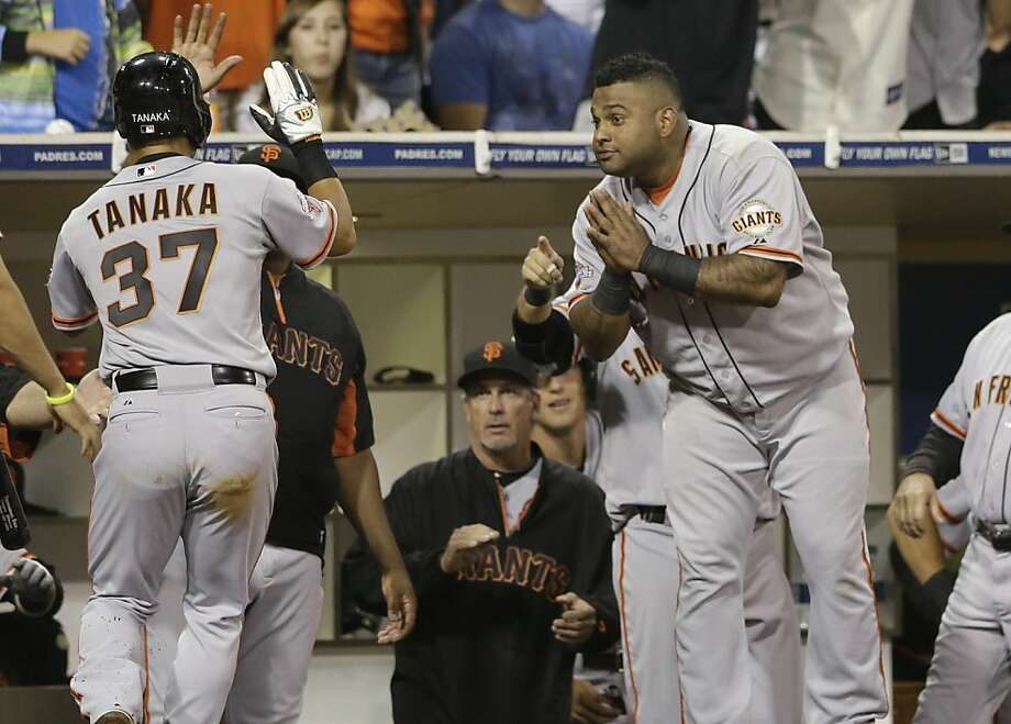 San Francisco Giants' Pablo Sandoval, right, bows to teammate Kensuke Tanaka, left, of Japan, after Tanaka scored on a double hit by Buster Posey during the eighth inning against the San Diego Padres  in a baseball game Thursday, July 11, 2013, in San Diego. (AP Photo/Gregory Bull) Photo: Gregory Bull, Associated Press