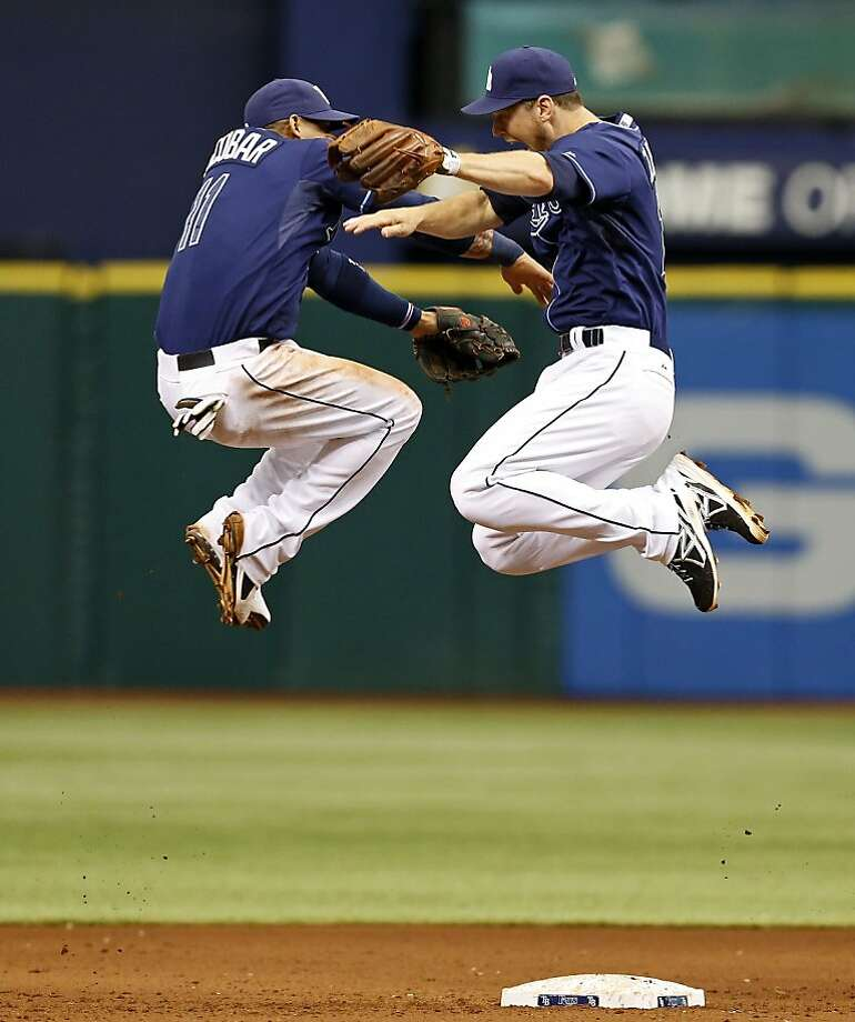 Tampa Bay Rays' Ben Zobrist, right, and Yunel Escobar celebrate at the end of a baseball game against the Minnesota Twins Thursday, July 11, 2013, in St. Petersburg, Fla. The Rays won 4-3. Photo: Mike Carlson, Associated Press
