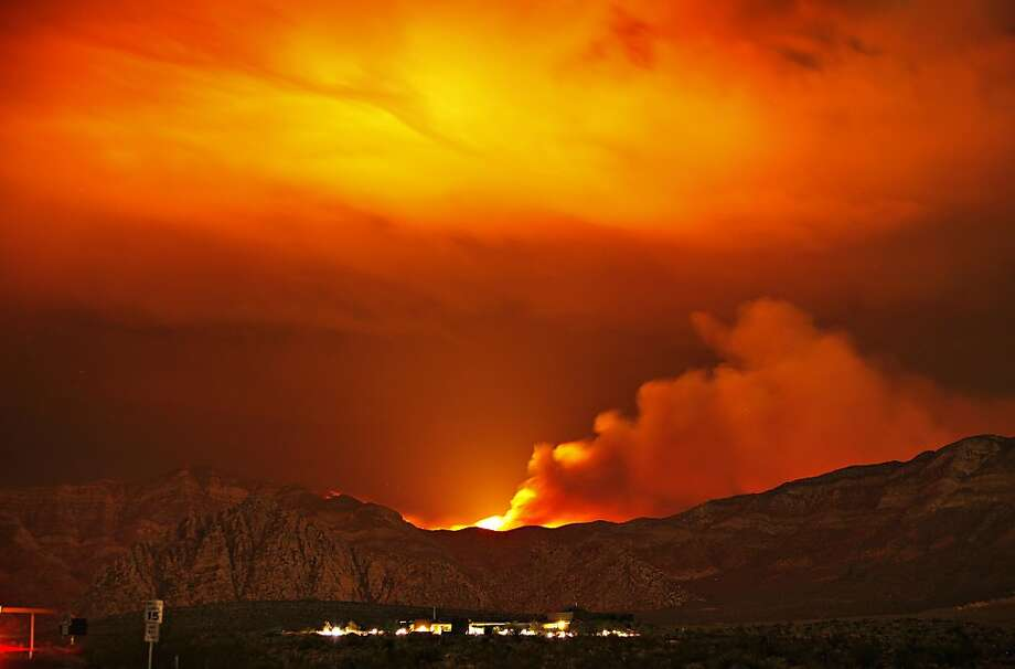 Nevada scorcher: The Carpenter 1 fire burns in the mountains behind the Red Rock Conservation Area visitor 